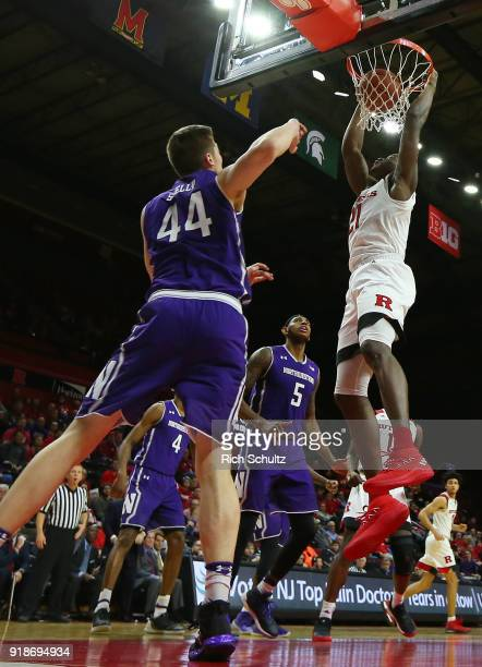 Mamadou Doucoure of the Rutgers Scarlet Knights dunks as Gavin Skelly of the Northwestern Wildcats defends during the second half of a game at...