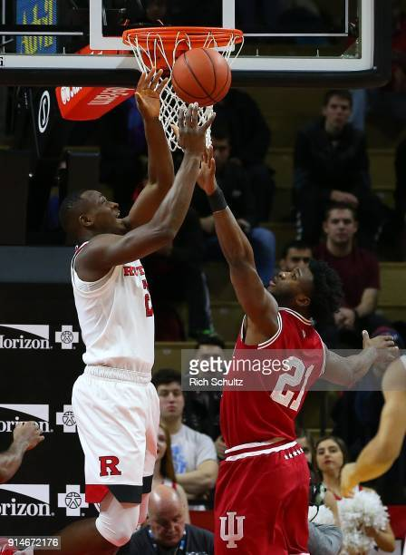 Mamadou Doucoure of the Rutgers Scarlet Knights goes up for ashot against Freddie McSwain Jr #21 of the Indiana Hoosiers defends during the first...