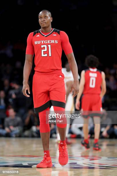 Mamadou Doucoure of the Rutgers Scarlet Knights reacts in the first half against the Minnesota Golden Gophers during the Big Ten Basketball...