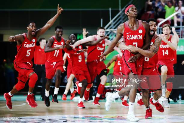 Mamadou Gueye of Canada celebrates with the team after shooting the winning shot to win the Men's semifinal match between New Zealand and Canada...