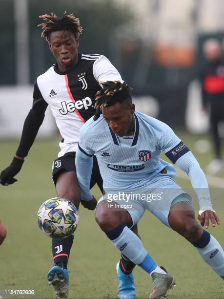Mamadou Kaly Sene of Juventus Turin U19 and Cedric Teguia of Atletico Madrid U19 battle for the ball during the UEFA Youth League match between...