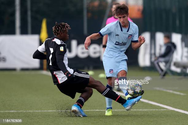 Mamadou Kaly Sene of Juventus Turin U19 and Fernando Medrano of Atletico Madrid U19 battle for the ball during the UEFA Youth League match between...