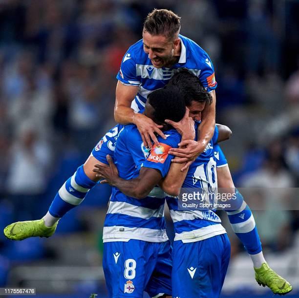 Mamadou Kone of Deportivo de La Coruna celebrates with his team mates after scoring his team's third goal during the La Liga Smartbank match between...