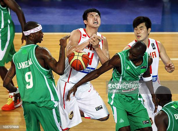 Mamadou Lamizana and Kinidinnin Konate of Cote d'Ivoire battles for the ball with Jinhui Ding of China at the 2010 World Championships of Basketball...