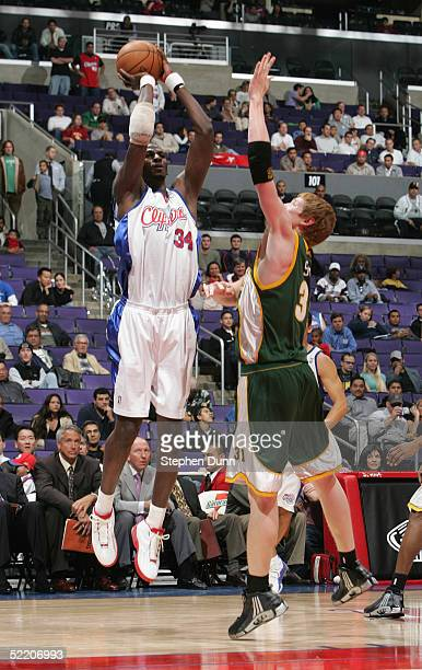 Mamadou N'diaye of the Los Angeles Clippers attempts to shoot over Robert Swift of the Seattle Sonics during the Clippers home opener at Staples...