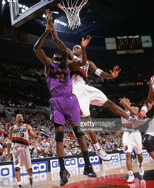 Mamadou N'diaye of the Toronto Raptors and Zach Randolph of the Portland Trail Blazers go to the basket during the NBA game at The Rose Garden on...