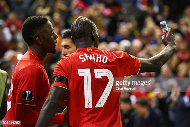 Mamadou Sakho and Divock Origi take a selfie after the UEFA Europa League quarter final second leg match between Liverpool and Borussia Dortmund at...