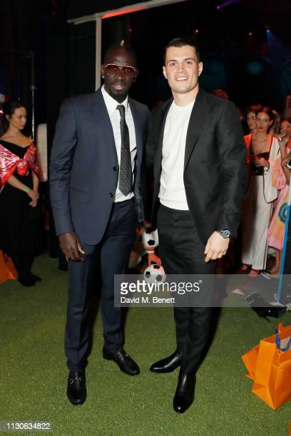 Mamadou Sakho and Granit Xhaka attend Naked Heart Foundation's Fund Fair with LuisaViaRoma at The Roundhouse on February 18 2019 in London England