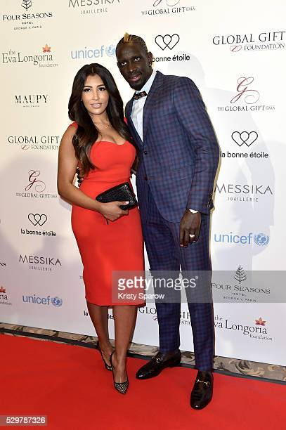 Mamadou Sakho and his wife Majda attend the Global Gift Gala Photocall at the Hotel Georges V on May 09 2016 in Paris France