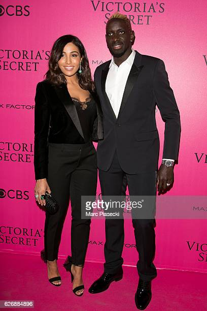 Mamadou Sakho and Majda Sakho attend '2016 Victoria's Secret Fashion Show' Pink carpet photocall at Le Grand Palais on November 30 2016 in Paris...