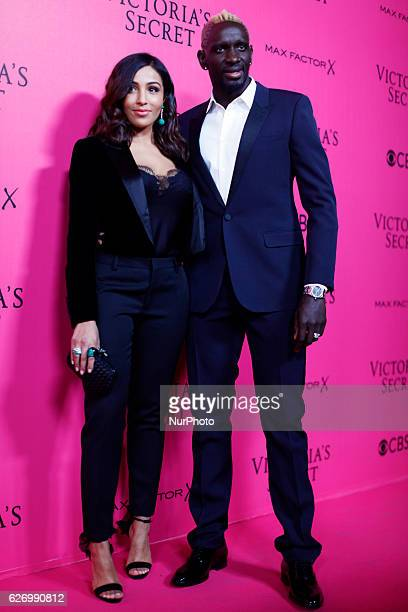 Mamadou Sakho and Majda Sakho attend the Pink Carpet before the Victoria's Secret Fashion Show at the Grand Palais in Paris on November 302016