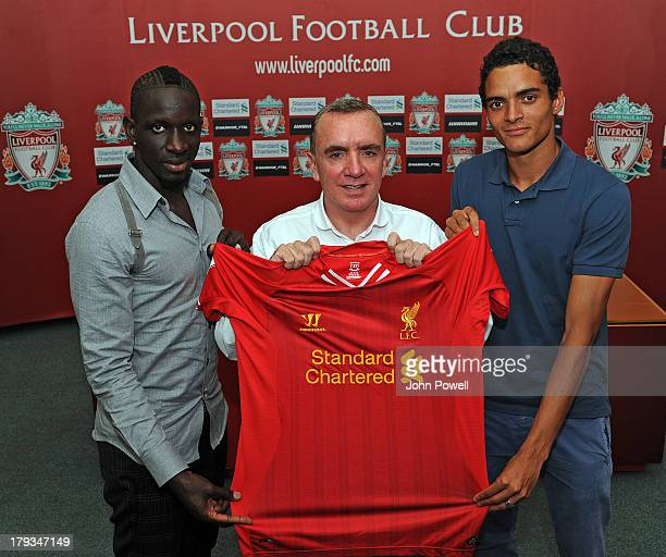 Mamadou Sakho and Tiago Ilori sign a contract for Liverpool Football Club with Managing Director Ian Ayre at Melwood Training Ground on August 31...