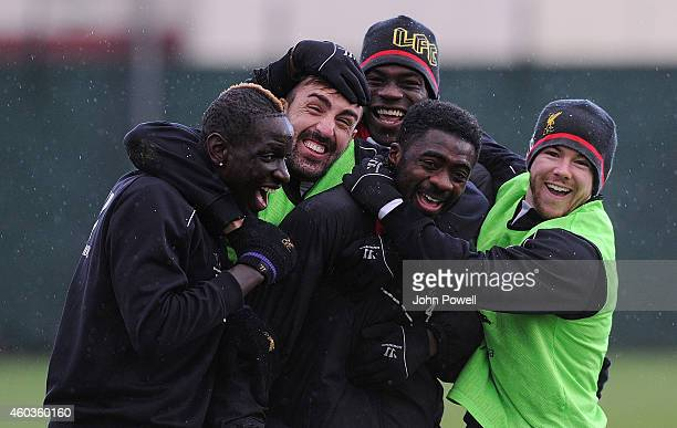 Mamadou Sakho Jose Enrique Kolo Toure Mario Balotelli and Alberto Moreno of Liverpool during a training session at Melwood Training Ground on...