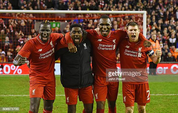 Mamadou Sakho Kolo Toure Christian Benteke and James Milner of Liverpool celebrates at the end of the the Capital One Cup Semi Final Second Leg...
