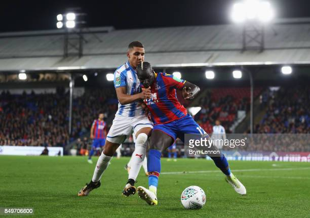 Mamadou Sakho of Crystal Palace and Abdelhamid Sabiri of Huddersfield during the Carabao Cup Third Round match between Crystal Palace and...