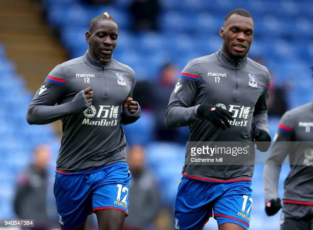 Mamadou Sakho of Crystal Palace and Christian Benteke of Crystal Palace warm up prior to the Premier League match between Crystal Palace and...
