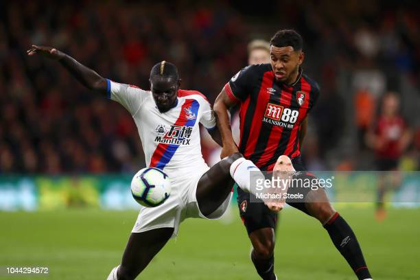 Mamadou Sakho of Crystal Palace battles for possession with Joshua King of AFC Bournemouth during the Premier League match between AFC Bournemouth...