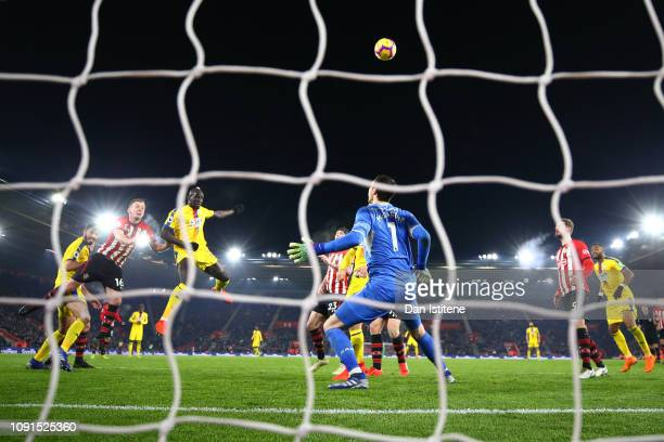 Mamadou Sakho of Crystal Palace heads the ball towards goal and misses under pressure from James WardProwse of Southampton during the Premier League...