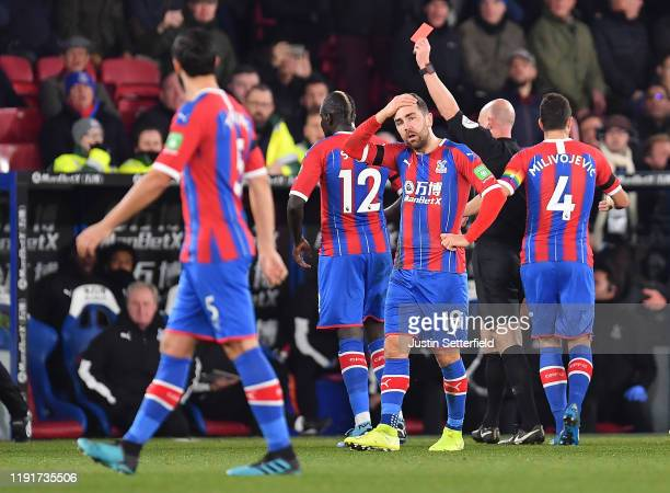 Mamadou Sakho of Crystal Palace is shown the red card by referee Anthony Taylor during the Premier League match between Crystal Palace and AFC...