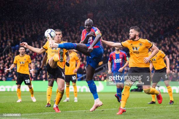 Mamadou Sakho of Crystal Palace Matt Doherty and Conor Coady of Wolverhampton chase for ball during the Premier League match between Crystal Palace...