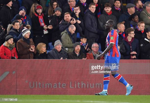 Mamadou Sakho of Crystal Palace walks off the pitch after he is shown the red card by referee Anthony Taylor during the Premier League match between...