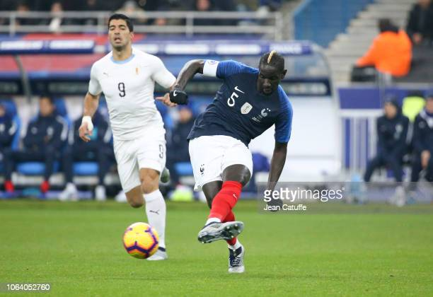 Mamadou Sakho of France Luis Suarez of Uruguay during the international friendly match between France and Uruguay at Stade de France on November 20...