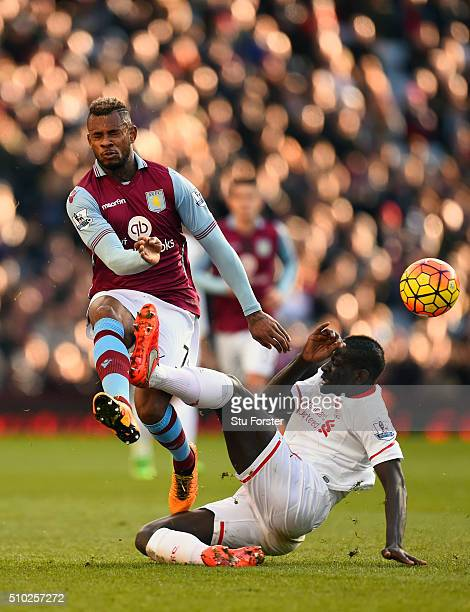 Mamadou Sakho of Liverpool challenges Leandro Bacuna of Aston Villa during the Barclays Premier League match between Aston Villa and Liverpool at...