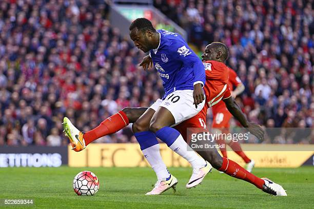 Mamadou Sakho of Liverpool makes a challenge on Romelu Lukaku of Everton during the Barclays Premier League match between Liverpool and Everton at...