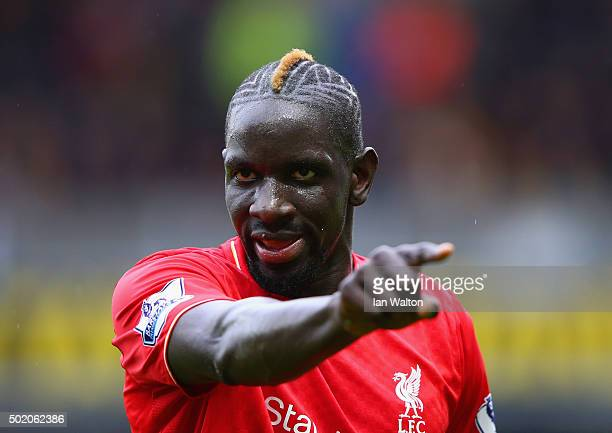 Mamadou Sakho of Liverpool points during the Barclays Premier League match between Watford and Liverpool at Vicarage Road on December 20 2015 in...