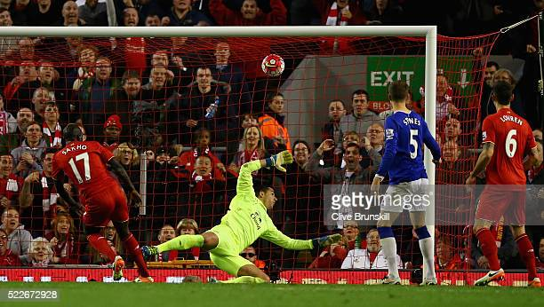 Mamadou Sakho of Liverpool scores his sides second goal during the Barclays Premier League match between Liverpool and Everton at Anfield April 20...