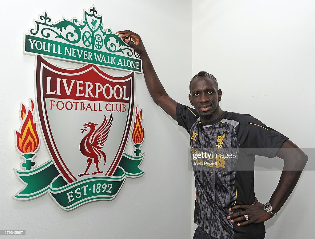 Mamadou Sakho poses for a photo after signing a contract for Liverpool Football Club at Melwood Training Ground on August 31, 2013 in Liverpool, United Kingdom.