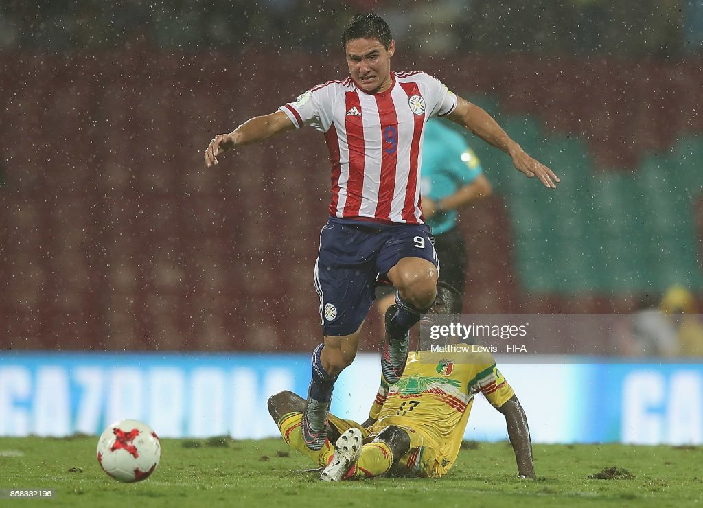 Mamadou Samake of Mali tackles Fernando Romero of Paraguay during the FIFA U-17 World Cup India 2017 group B match between Paraguay and Mali at Dr DY Patil Cricket Stadium on October 6, 2017 in Mumbai, India.