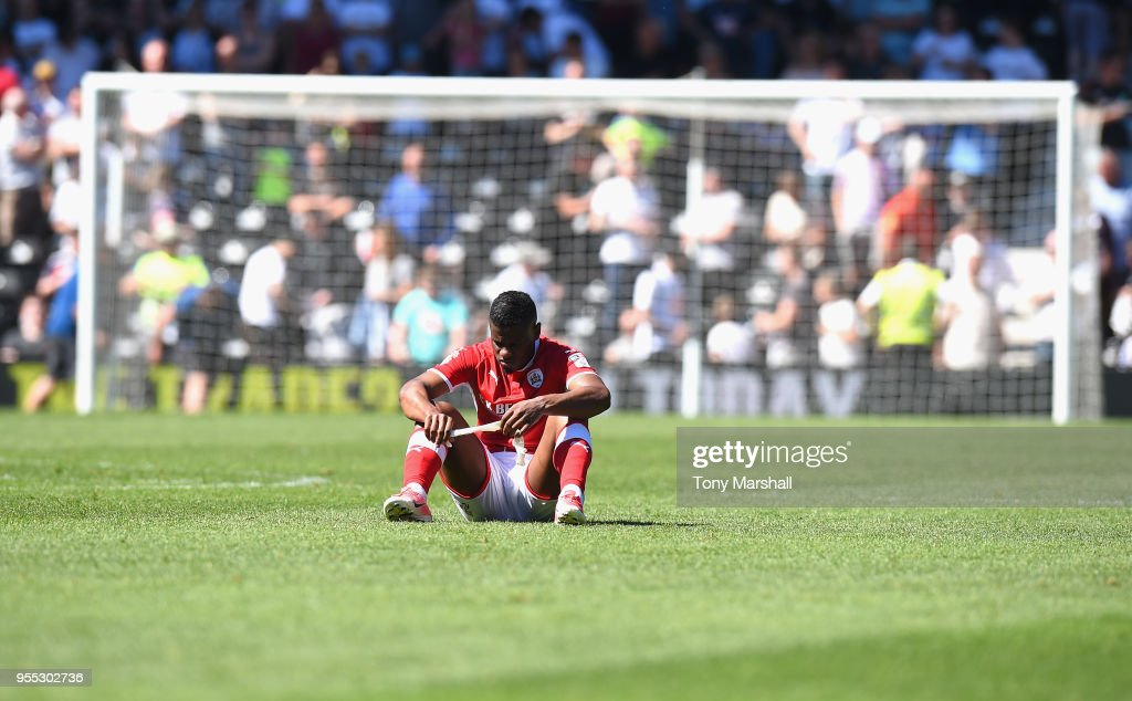 Mamadou Thiam of Barnsley sits dejected on the pitch as Barnsley are relegated during the Sky Bet Championship match between Derby County and Barnsley at iPro Stadium on May 6, 2018 in Derby, England.