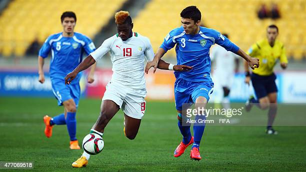 Mamadou Thiam of Senegal is challenged by Ibrokhim Abdullaev of Uzbekistan during the FIFA U20 World Cup New Zealand 2015 Quarter Final match between...