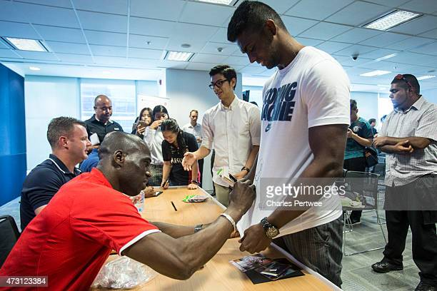 Mamady Sidibe former Stoke player signs a fans tshirt during a QA at the Barclays office during the Barclays Asia Trophy 2015 Ticket Launch day 2 on...