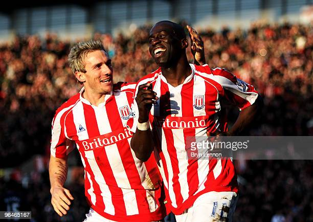 Mamady Sidibe of Stoke City celebrates scoring with team mate Liam Lawrence during the Barclays Premier League match between Stoke City and Blackburn...