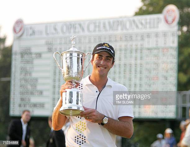 Mamaroneck, UNITED STATES: Geoff Ogilvy of Australia displays his trophy after winning the 2006 US Open Championships 18 June 2006 at Winged Foot...