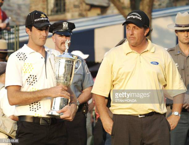 Mamaroneck, UNITED STATES: Geoff Ogilvy of Australia holds the trophy after winning the US Open Championship 18 June 2006 at Winged Foot Golf Club in...