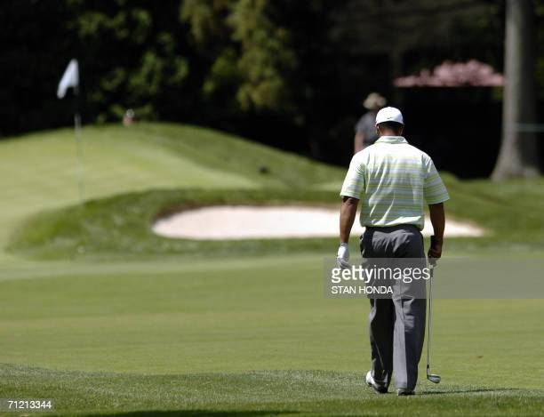 Mamaroneck, UNITED STATES: Tiger Woods of the US walks to the 4th green during the US Open Championship 15 June 2006 at Winged Foot Golf Club in...