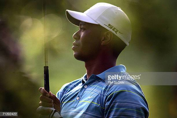 Mamaroneck, UNITED STATES: Tiger Woods of the US, watches his approach shot from the 12th fairway during practice rounds for the 106th US Open Golf...