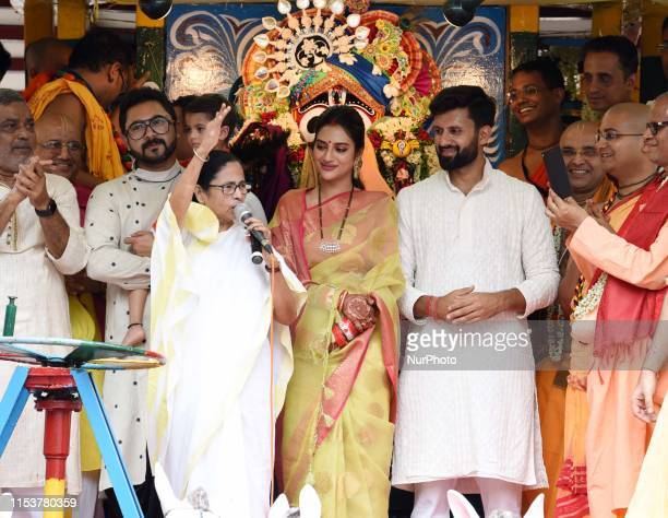 Mamata Banerjee Chief Minister of West Bengal along Actress Nusrat Jahan participate in the annual festival of ISCON Rath Yatra in Kolkata India...