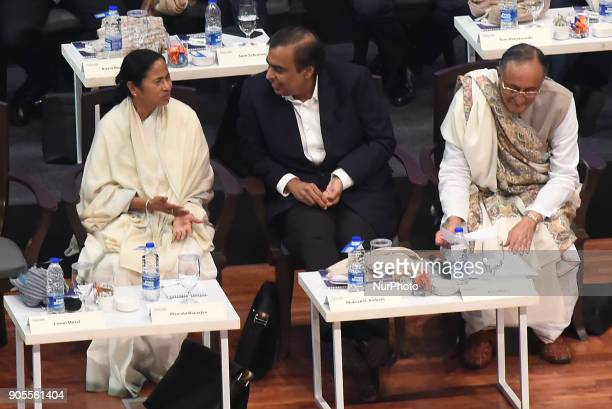 Mamata Banerjee Chief Minister of West Bengal along Mukesh Ambani Chairman and MD Reliance Industry Limited and Amit Mitra State Finances Minister at...
