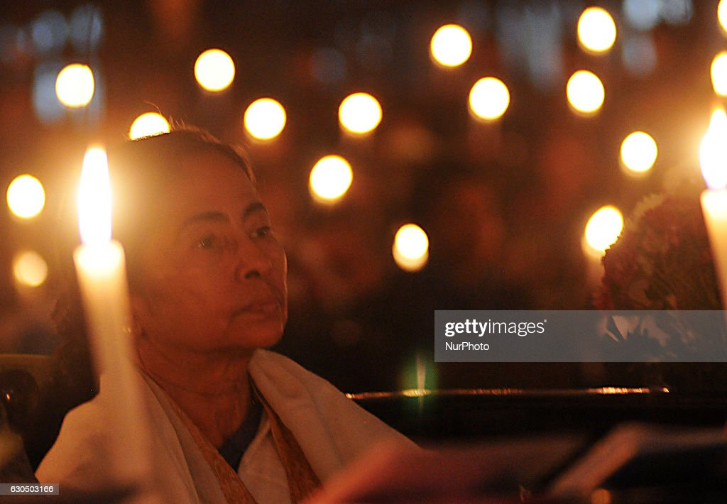 Mamata Banerjee Chief Minister of West Bengal at the Mid Night Candle Light pray at the St Paul's Church on the occasion Christmas on December 24,2016 in Kolkata,India.