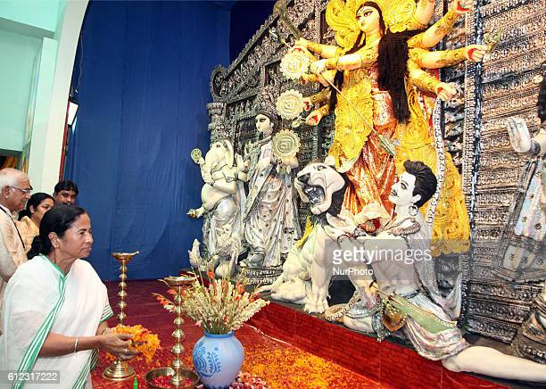 Mamata Banerjee Chief Minister of West Bengal inauguration Durgapuja PandalIndian visitors gather around a statue of the Hindu goddess Durga in...