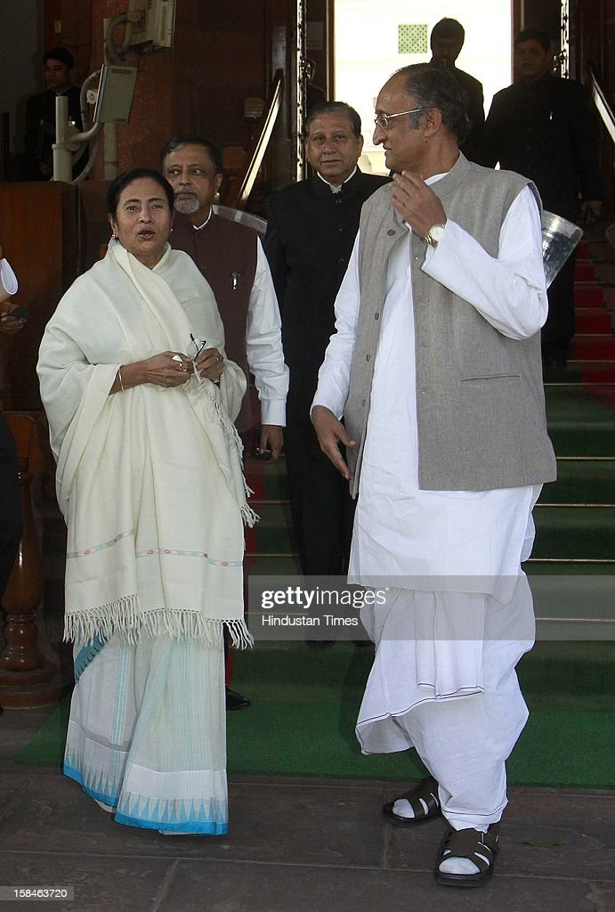 Mamata Banerjee Chief Minister of West Bengal with Amit Mitra finance Minister West Bengal, former Railway Minister Mukul Ray arrive at parliament house during the parliament winter session on December 17, 2012 in New Delhi, India.