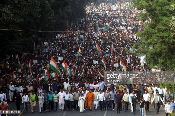 Mamata Banerjee, the Chief Minister of West Bengal and Chief Of Trinamool Congress Political Party and her party supporters attend a protest against...