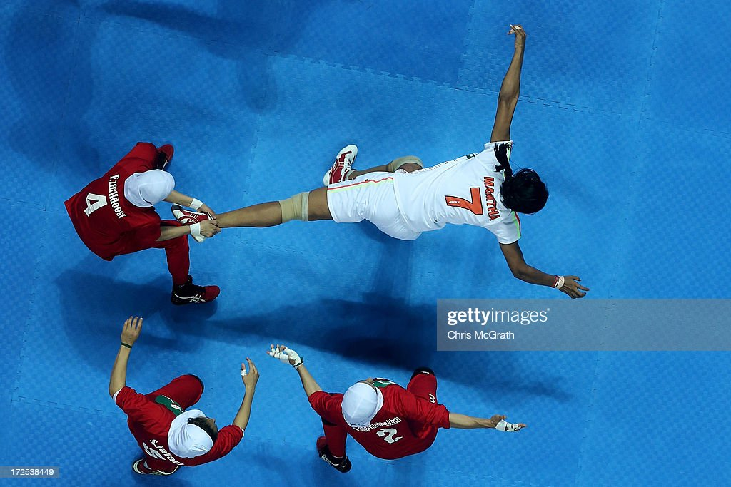 Mamatha Mamatha #7 of Independent Olympic Athletes is caught by Zarif Doost Farideh #4 of Iran during the Women's Kabaddi Gold Medal match at Ansan Sangnoksu Gym on day five of the 4th Asian Indoor & Martial Arts Games on July 3, 2013 in Incheon, South Korea.