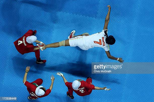 Mamatha Mamatha of Independent Olympic Athletes is caught by Zarif Doost Farideh of Iran during the Women's Kabaddi Gold Medal match at Ansan...