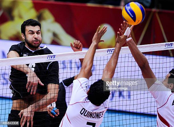 Mamdouh Abdelrehim of Egypt attacks against Jorge Quinones and Tomas Aguilera of Mexico during the FIVB World Championships match between Egypt and...