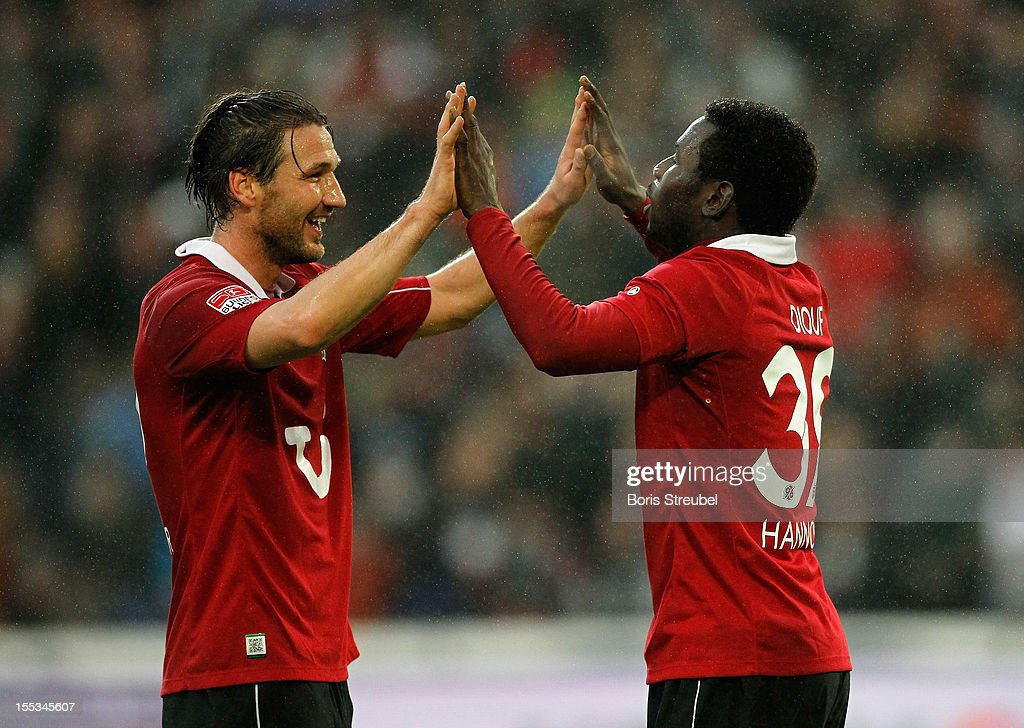 Mame Biram Diouf (R) of Hannover celebrates after scoring his team's first goal with his team mate Christian Schulz during the Bundesliga match between Hannover 96 and FC Augsburg at AWD Arena on November 3, 2012 in Hannover, Germany.
